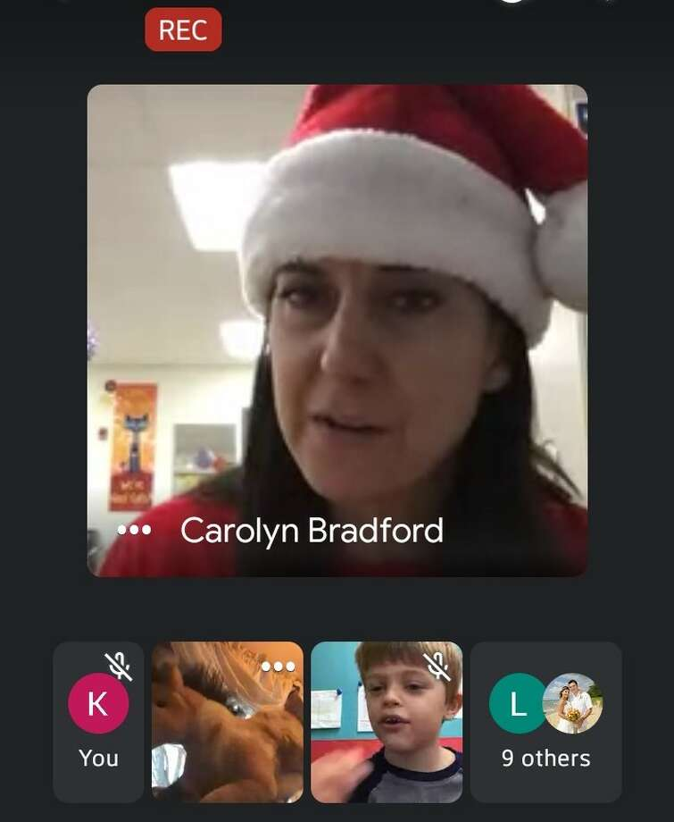 """Carolyn Bradford, a first grade teacher at Onekama Consolidated Schools, leads a Google Meet in which students were encouraged to wear pajamas and drink hot cocoa as Bradford read """"The Polar Express."""" Remote learning has been difficult for families without internet access or someone to watch the students. Photo: Screenshot/Google Meet"""