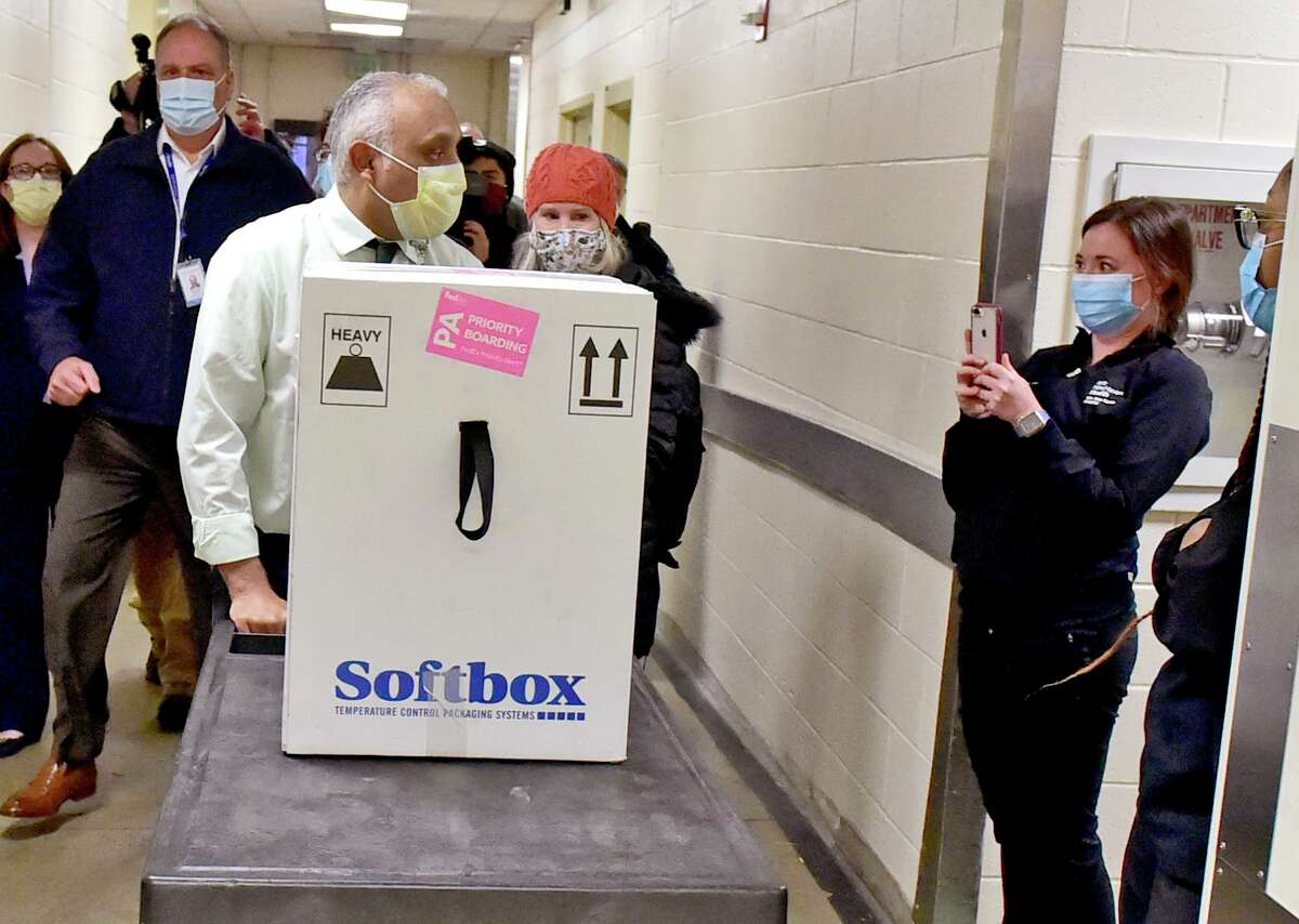 A cart that contains a delivery of the Pfizer Pfizer-BioNTech COVID-19 vaccine arrives Tuesday morning at Yale New Haven Hospital in New Haven.