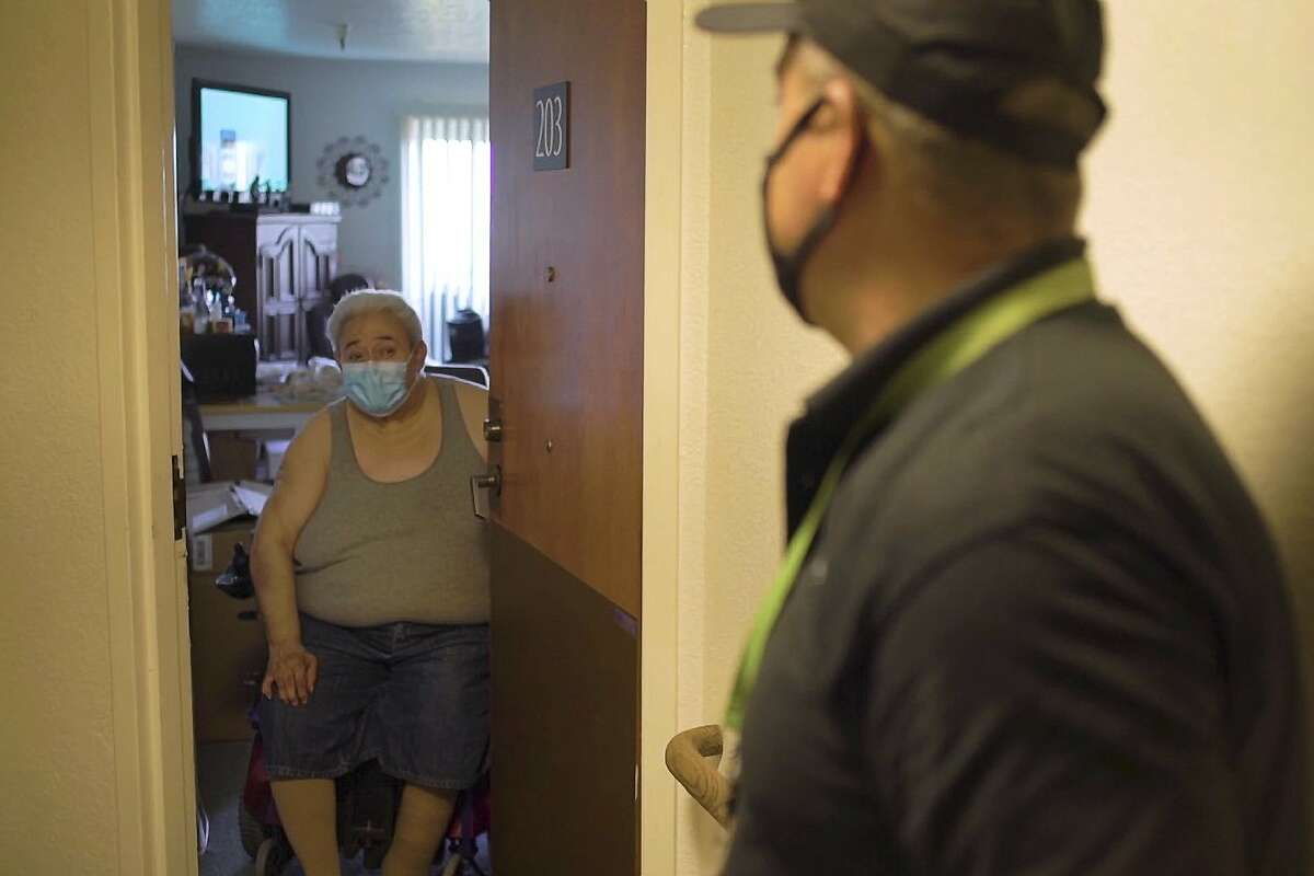 Michael Torres (right) delivers food every afternoon to seniors throughout San Francisco through On Lok and has befriended one man in particular, Jose Garcia (left) , who rarely sees anybody else all day as he holes up to avoid COVID.