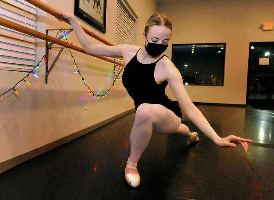 "Millicent Collins, 18, of Collinsville during class at the Turning Point Academy of Dance in Maryville Thursday. She and her classmates will be performing in a virtual performance of the Nutcracker called ""Clara's Dream, Nutcrackers Past and Present."" Photo: Thomas J. Turney 