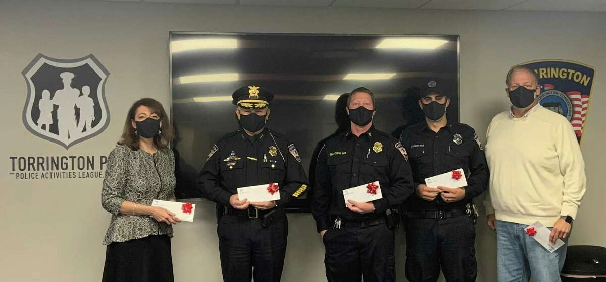 From left are Torrington Public Schools Superintendent Susan Lubomski, Police Chief William Baldwin, Captain Bart Barown, Officer Simon and Chris Smedick- PAL Executive Director .