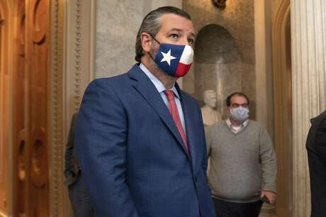 Senator Ted Cruz, a Republican from Texas, left, wears a protective mask while departing the Senate Floor at the U.S. Capitol in Washington, D.C., U.S., on Wednesday, Dec. 2, 2020.