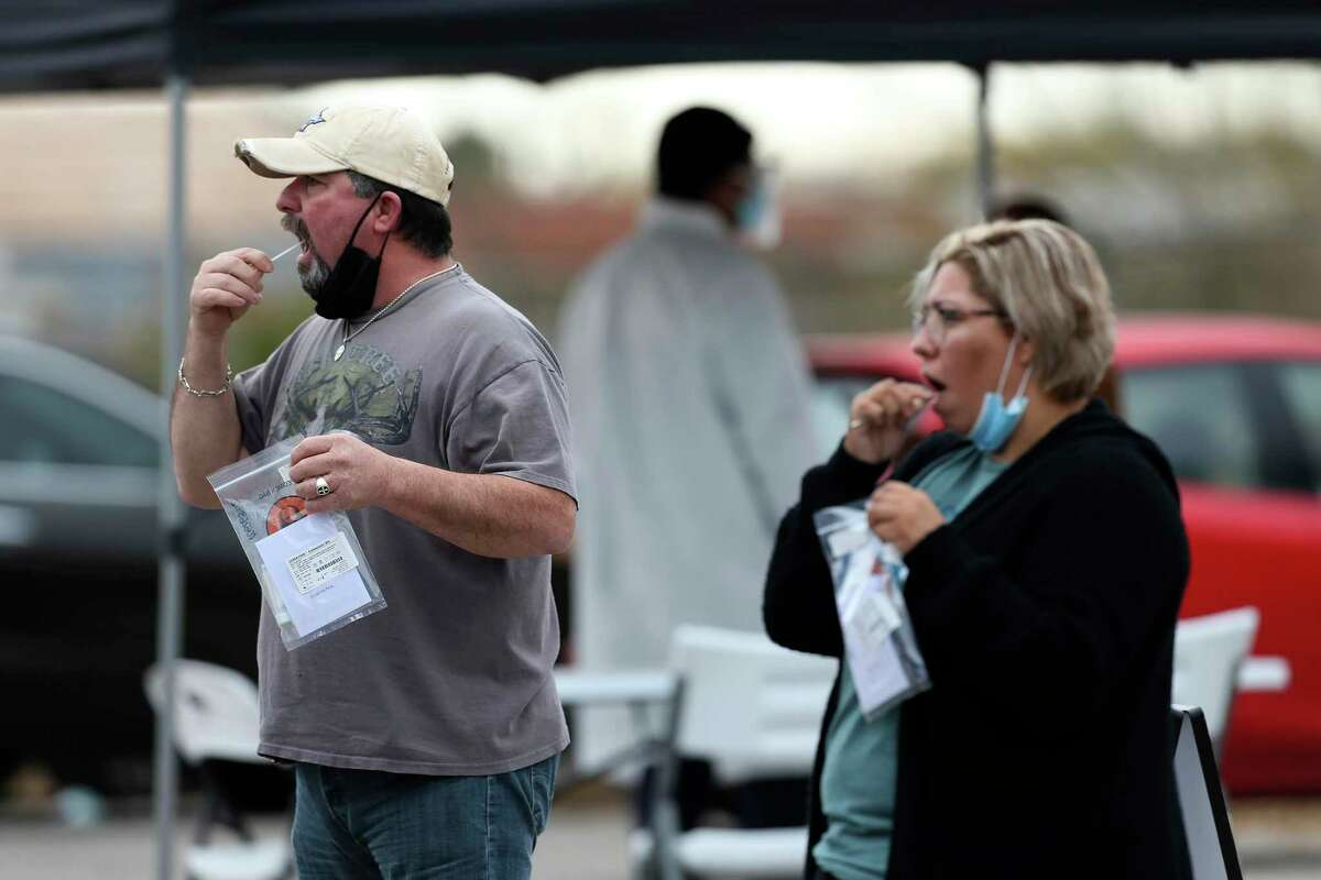People get tested for COVID-19 at a popup testing site on South Zarzamora Street on Friday. Over half of San Antonio's COVID-19 deaths are in South and West San Antonio.