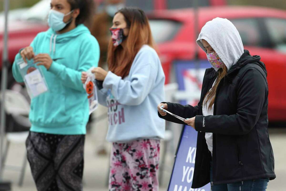 People get tested for COVID-19 at a popup testing site on South Zarzamora Street on Friday.