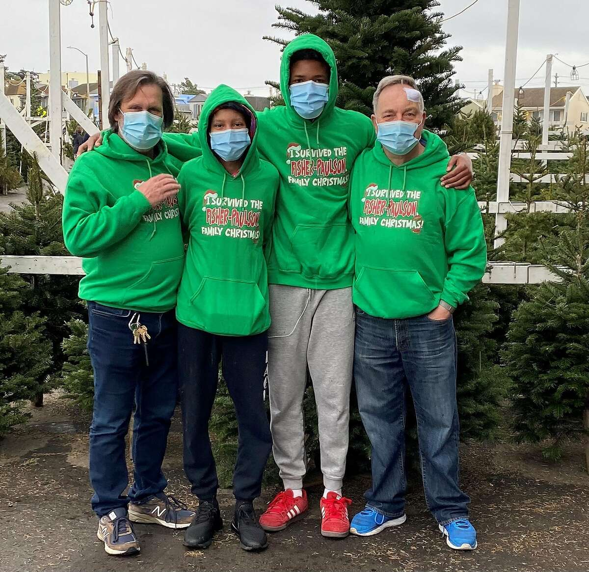 Chronicle columnist Kevin Fisher-Paulson (right) poses for a photo with his family in a Christmas tree lot, one day after undergoing surgery for Basal cell carcinoma, the most common form of skin cancer.