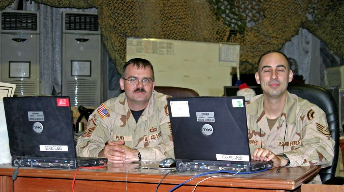 Chief Master Sgt. Shawn Peno, left, is on duty in Iraq.