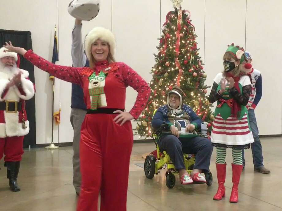 Christmas Style - Conroe Noon Lions Club member Lindsey Kasprzak (center) shows off her holiday lama outfit during the best dressed Christmas Spirit style show at the club's annual Christmas Social on Wednesday. Also pictured (l-r) Santa, Bobby Brennan, Eddie Risha, Karen Lonon, Mason Dupuis. Photo: Courtesy Photo