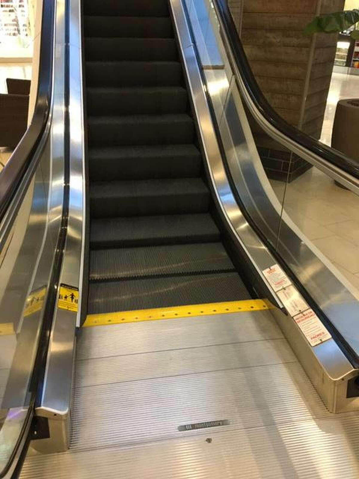 The escalator in the Westfield Trumbull mall where a toddler was injured in 2018. Her mother is suing the mall and the escalator company.