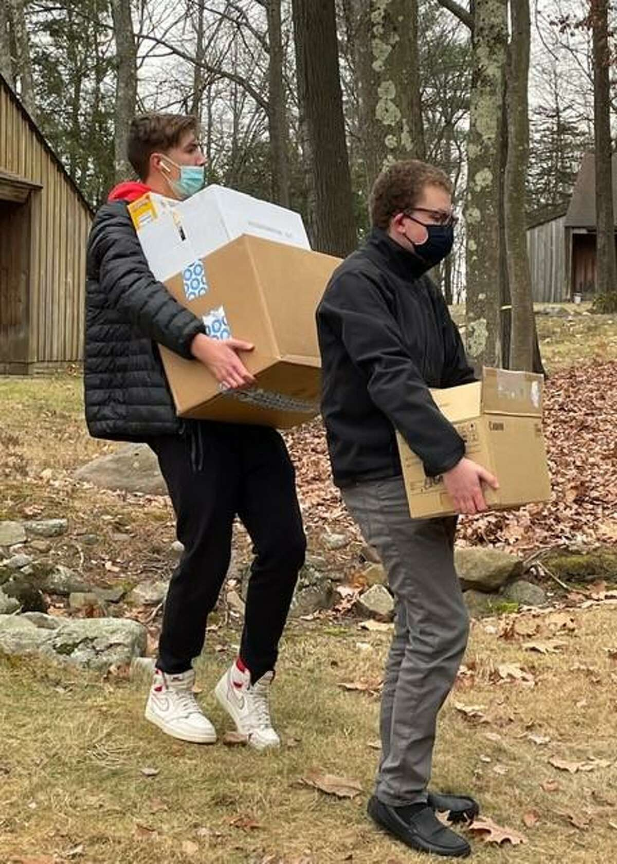 The Master's School National Honor Society students load up the food the school's students collected from Nov. 15-Dec. 15, to deliver to FISH in Torrington on Wednesday.