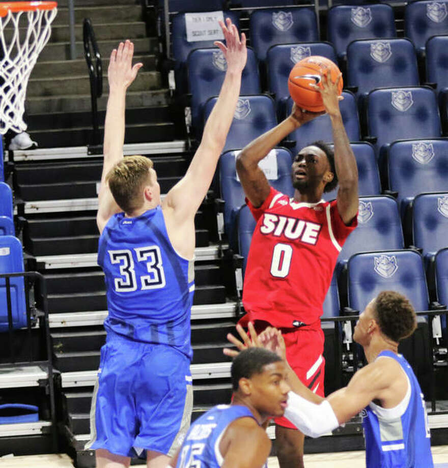 SIUE's Sidney Wilson (0), shown shooting over SLU's Marten Linssen (33) during a Nov. 25 game in St. Louis, scored 18 points to lead the Cougars to a OVC victory over Morehead State on Friday night in Morehead, Ky. Photo: Greg Shashack / The Telegraph