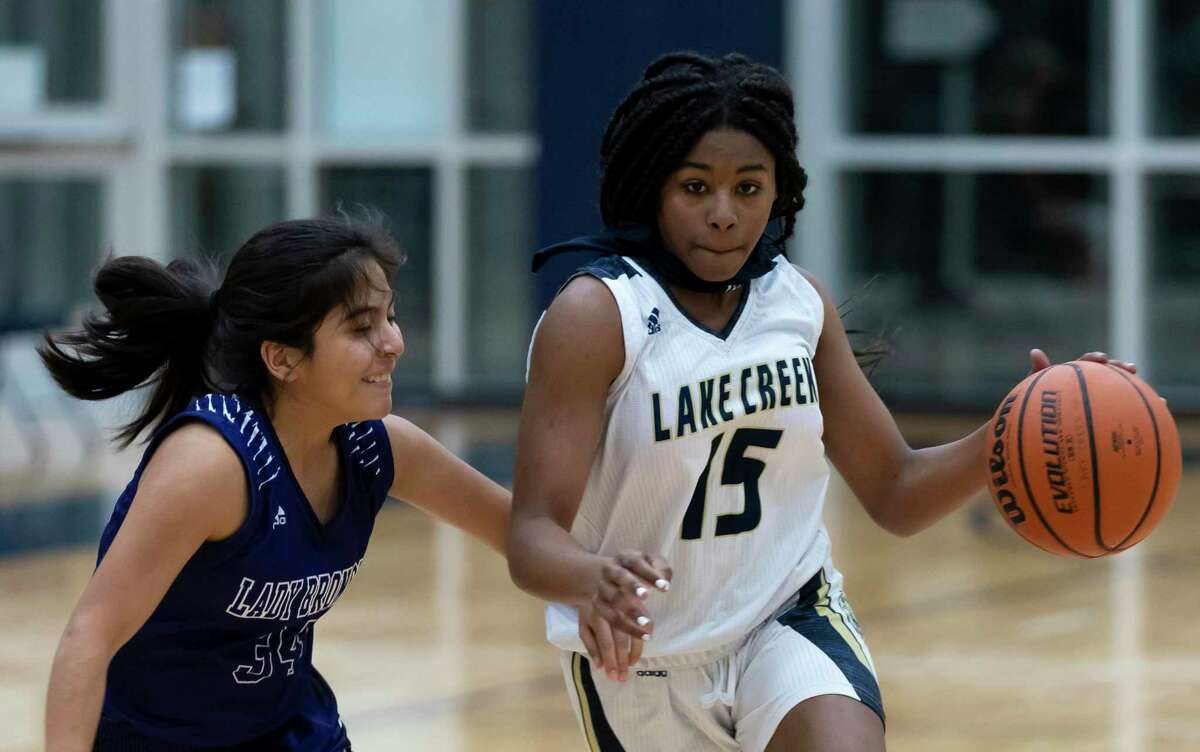 Lake Creek point guard Taliyah Mcshan (15) drives the ball while under pressure from Dayton guard Samantha Sanchez (34) during the fourth quarter of a non-district girls basketball game at Lake Creek High School, Tuesday, Dec. 15, 2020, in Montgomery.