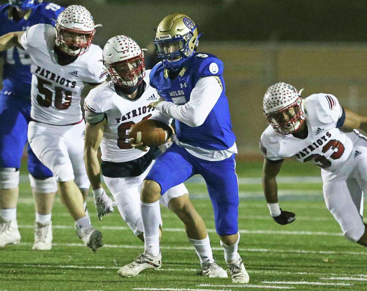Mules quarterback James Sobey breaks through the middle for a first down as Alamo Heights plays Georgetown East View at Comalander Stadium in high school football playoffs Stadium on Dec. 18, 2020.