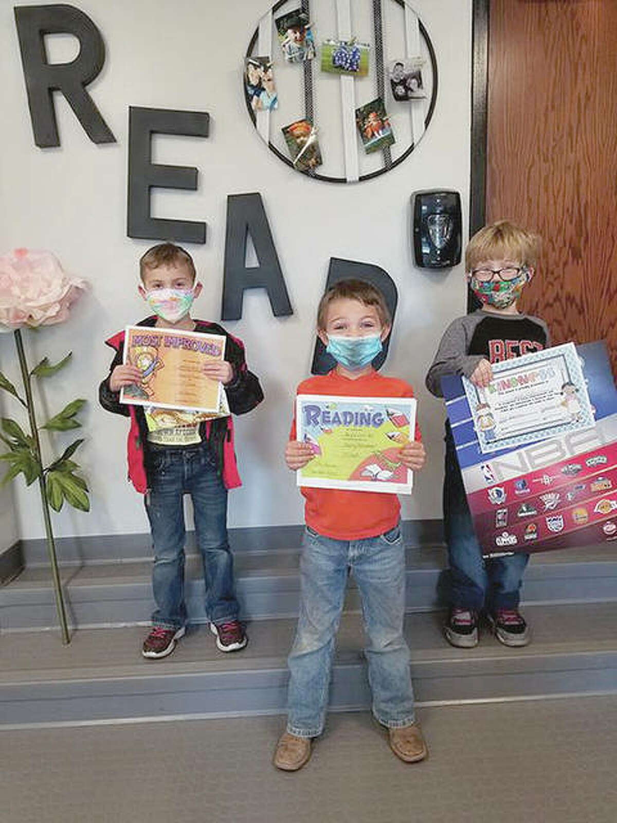 First-grade student of the month was Jason Scott (right), for displaying the character trait kindness. Camdyn White (left) was recognized as most improved reader and Bryce Scott Hall was recognized as the top reader.