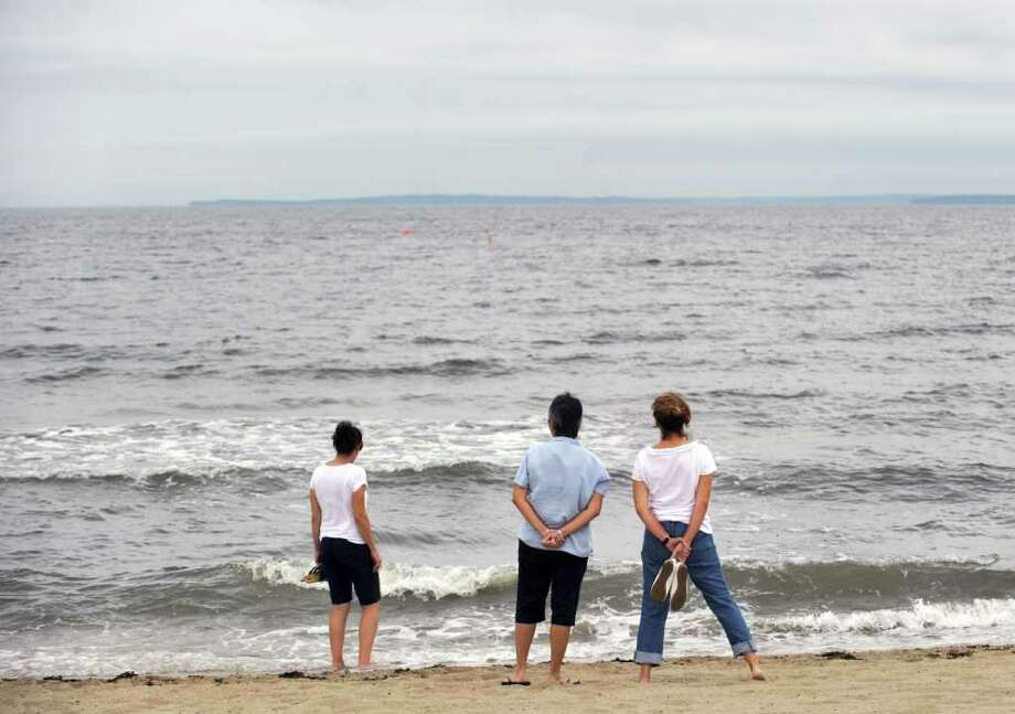 Pam Geatz of Greenwich, left, and friends Siu-Sing Shantur, Anita Richards, center and left, both of Ithaca, N.Y., look south from Greenwich Point at a placid Long Island Sound, early Friday evening, Sept. 3, 2010.  Hurricane Earl passed so far out to sea that none of its devastating or ancillary effects were felt in Greenwich. Photo: Bob Luckey / Greenwich Time