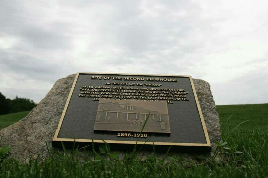 One of the three plaques that can be found at the Greenwich Country Club golf course designating the location of one of the three past clubhouses. Photo: David Ames, David Ames/For Greenwich Time / Greenwich Time Freelance