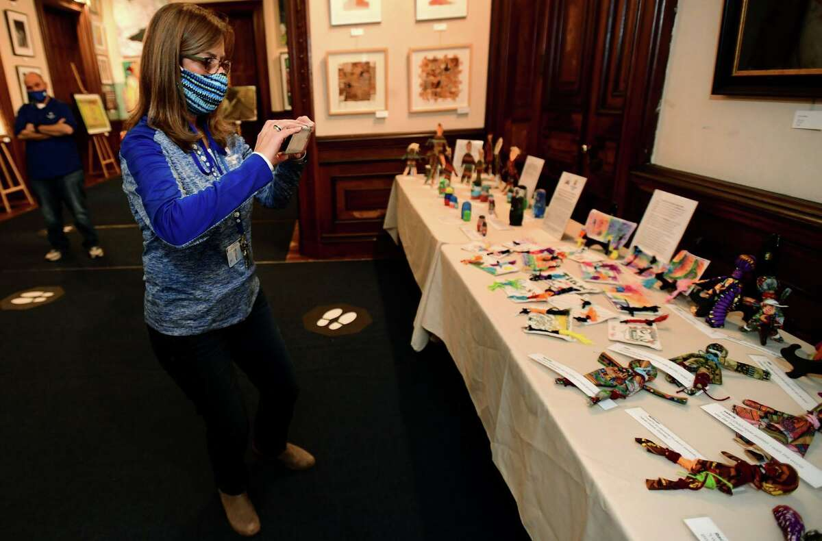 Tracey Elementary School teachers including Kim Bonaddio visit Lockwood-Matthews Mansion Tuesday, November 8, 2020, to kick off the exhibit of dolls from around the world that the 4th grade students made in partnership with the mansion.
