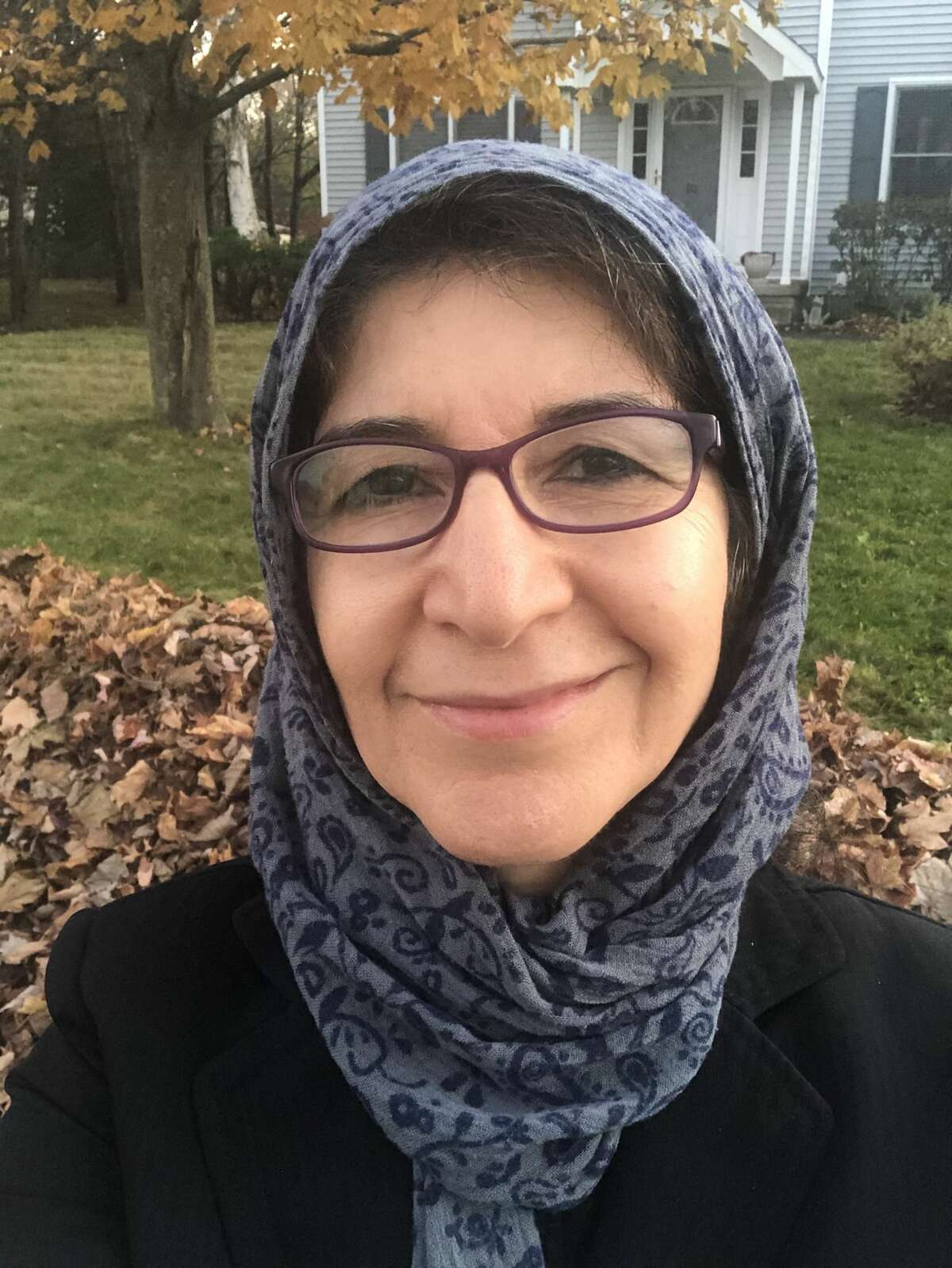 Ilham Almahamid outside of her Slingerlands home.