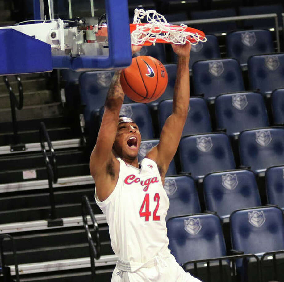 SIUE's Shamar Wright throws down a dunk during a Cougars' win over Health Sciences and Pharmacy during the Billiken Classic on Nov. 28 at Chaifetz Arena in St. Louis. SIUE is home on Monday for an OVC game with Eastern Illinois. Photo: Greg Shashack / The Telegraph