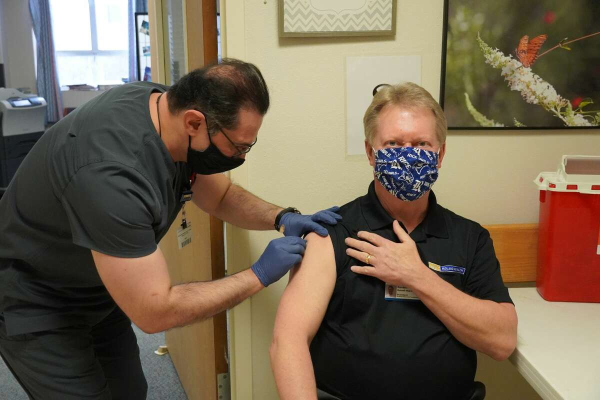 President and CEO Russell Meyers received the COVID vaccine Friday. Midland Health received 1,950 doses of the Pfizer coronavirus vaccine Thursday, December 17, 2020, and staff immediately began administering those vials to hospital workers.