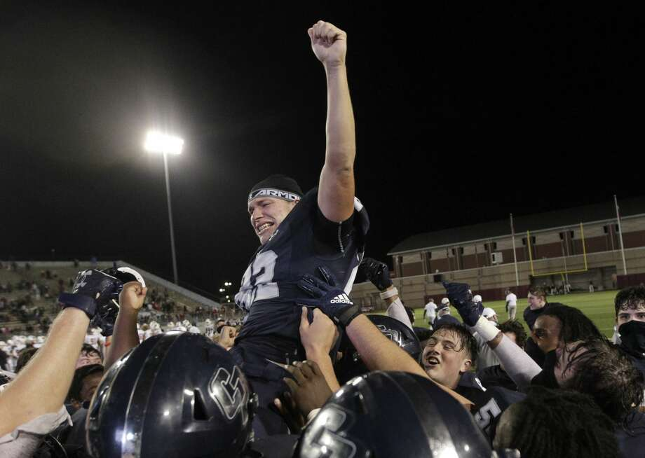 College Park running back Dylon DeAngelo (22) is lifted into the air by teammates after he scored the game-winning 14-yard touchdown to give the Cavaliers a 35-31 win over The Woodlands for the District 13-6A championship at Woodforest Bank Stadium, Friday, Nov. 27, 2020, in Shenandoah. Photo: Jason Fochtman/Staff Photographer / 2020 © Houston Chronicle
