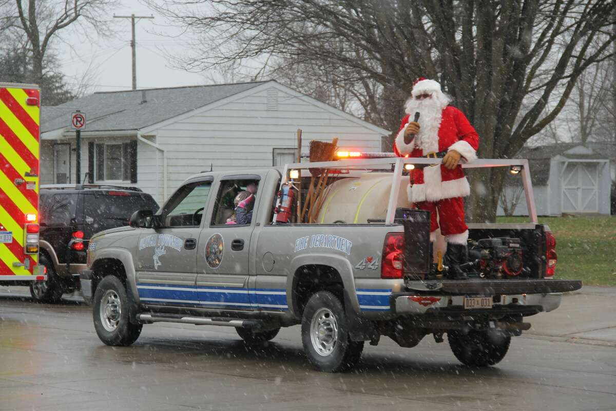 Santa Claus made a special visit to Elkton on Saturday afternoon, saying hello to the kids in the village. Santa was escorted by an Oliver Township fire truck, Elkton Police cars, and other cars handing out bags of candy.