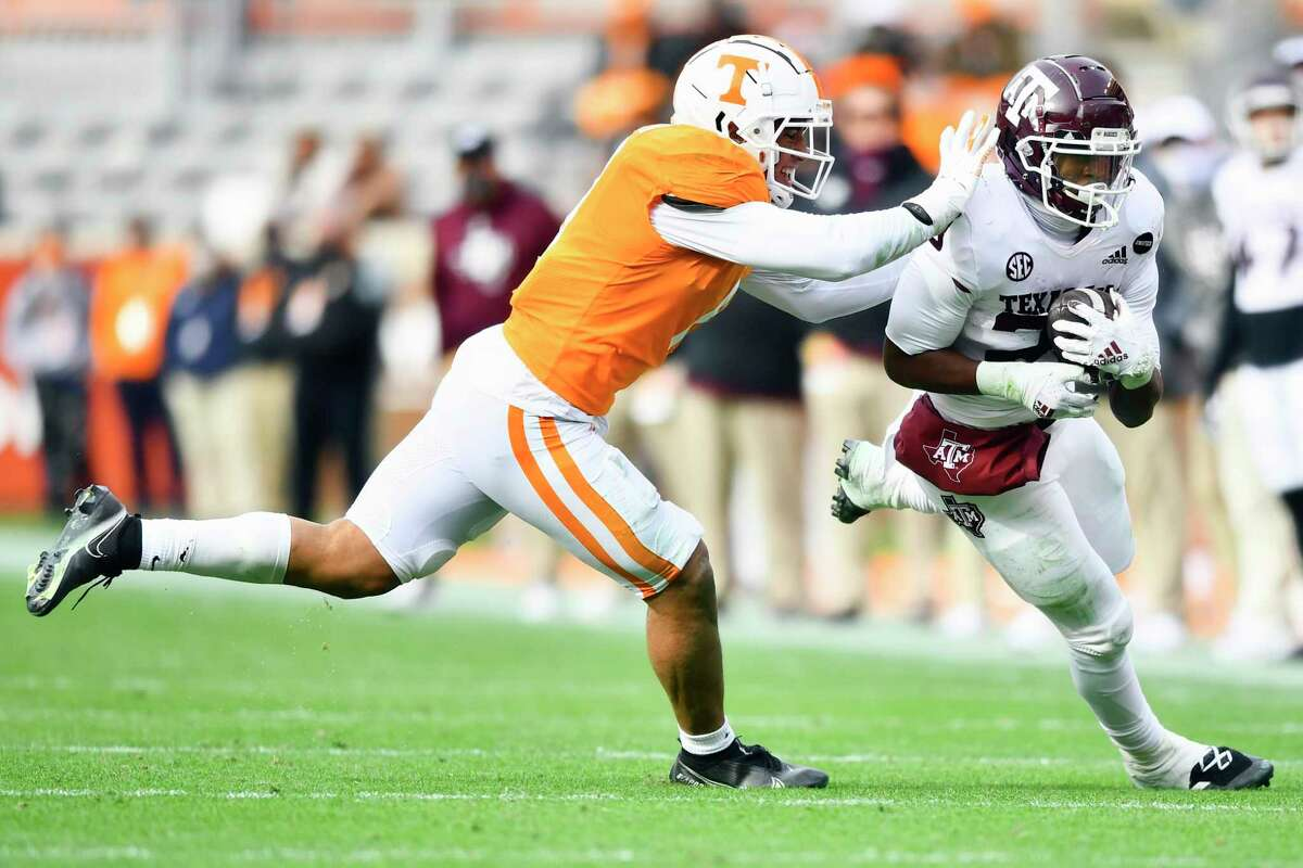Tennessee linebacker Henry To'o To'o (11) tackles Texas A&M running back Isaiah Spiller (28) during an NCAA college football game in Neyland Stadium in Knoxville, Tenn., Saturday, Dec. 19, 2020. (Brianna Paciorka/Knoxville News Sentinel via AP, Pool)
