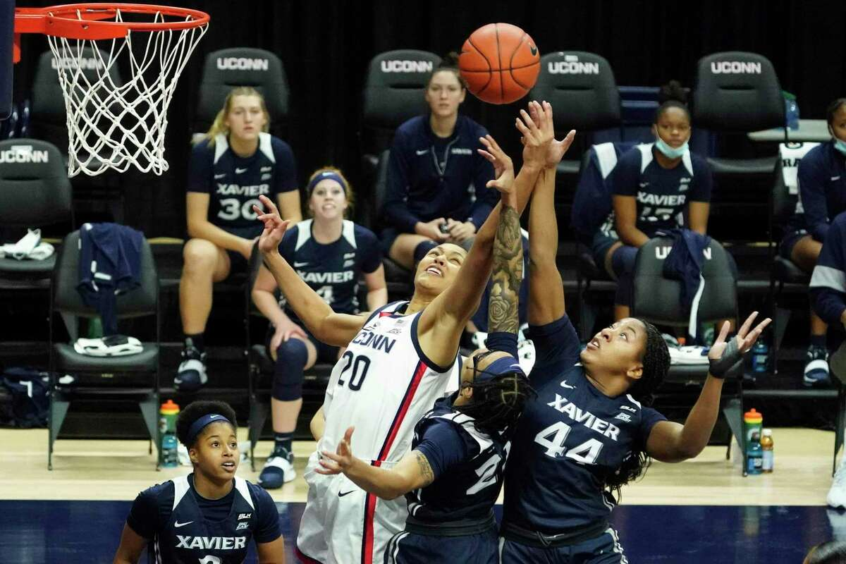 UConn's Olivia Nelson-Ododa (20) and Xavier forward Ayanna Townsend battle for a rebound during the first half Saturday in Storrs.
