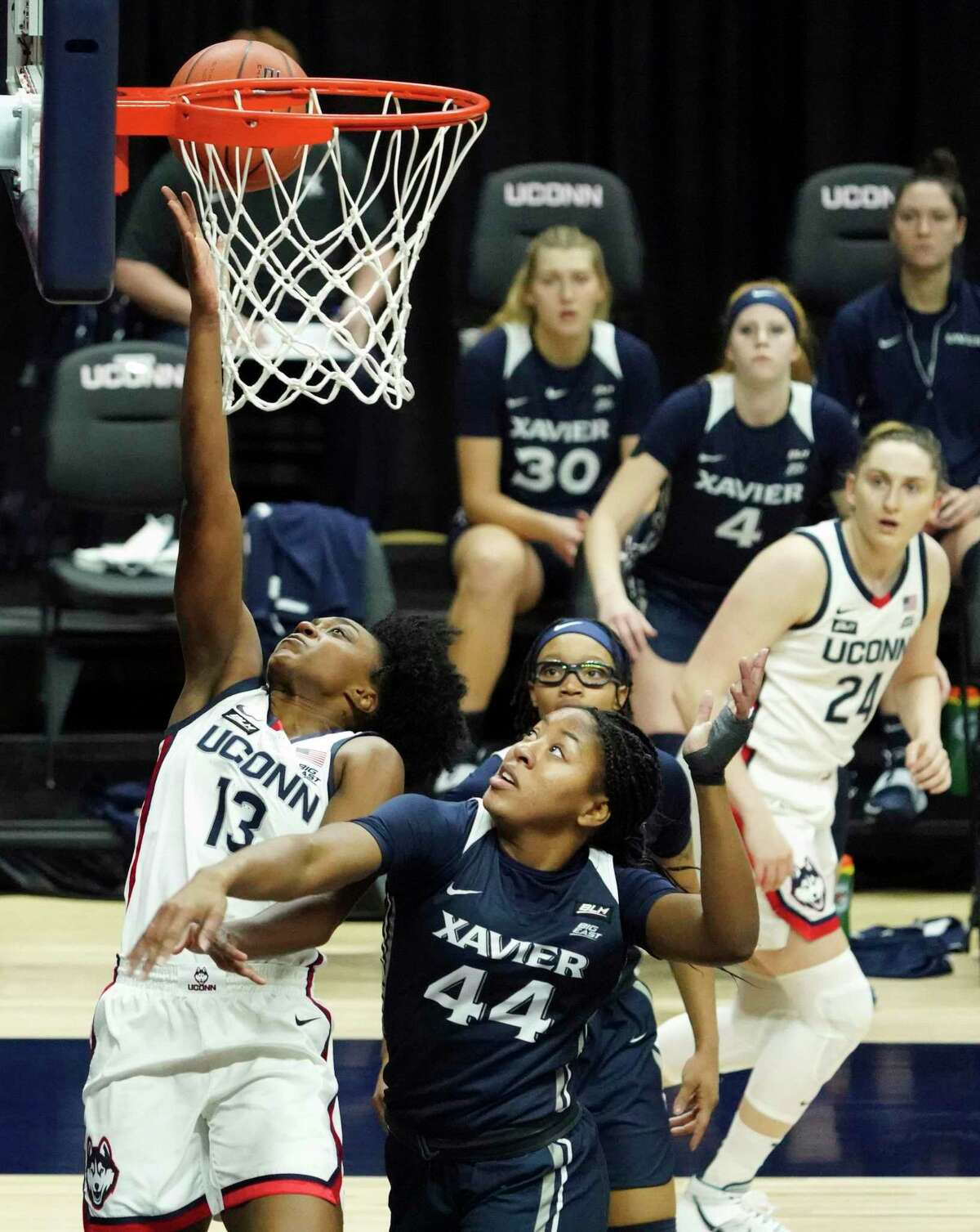 UConn's Christyn Williams (13) shoots and is fouled by Xavier's Ayanna Townsend during the first half Saturday in Storrs.