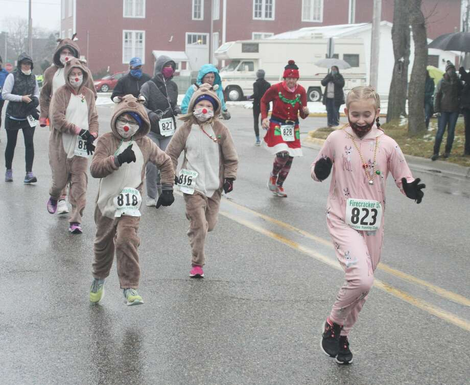 The Jingle Bell Jog 5K was held Saturday, Dec. 19, 2020 in Manistee. The event, which typically coincides with Manistee's annual Victorian Sleighbell Parade and Old Christmas Weekend was scaled down this season due to COVID-19 restrictions. Photo: Dylan Savela/News Advocate