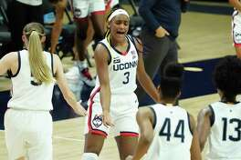 Connecticut forward Aaliyah Edwards (3) reacts with teammates after a basket and foul against Xavier during the first half of an NCAA college basketball game, Saturday, Dec. 19, 2020, in Storrs, Conn.