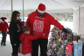 The Mecosta VFW Post No. 2335 hosted a drive-thru Christmas party Saturday, allowing area families to stop by for food, hot chocolate, coffee and more. During the event, kids also had the chance to get out of their vehicles and select a toy for the holidays.