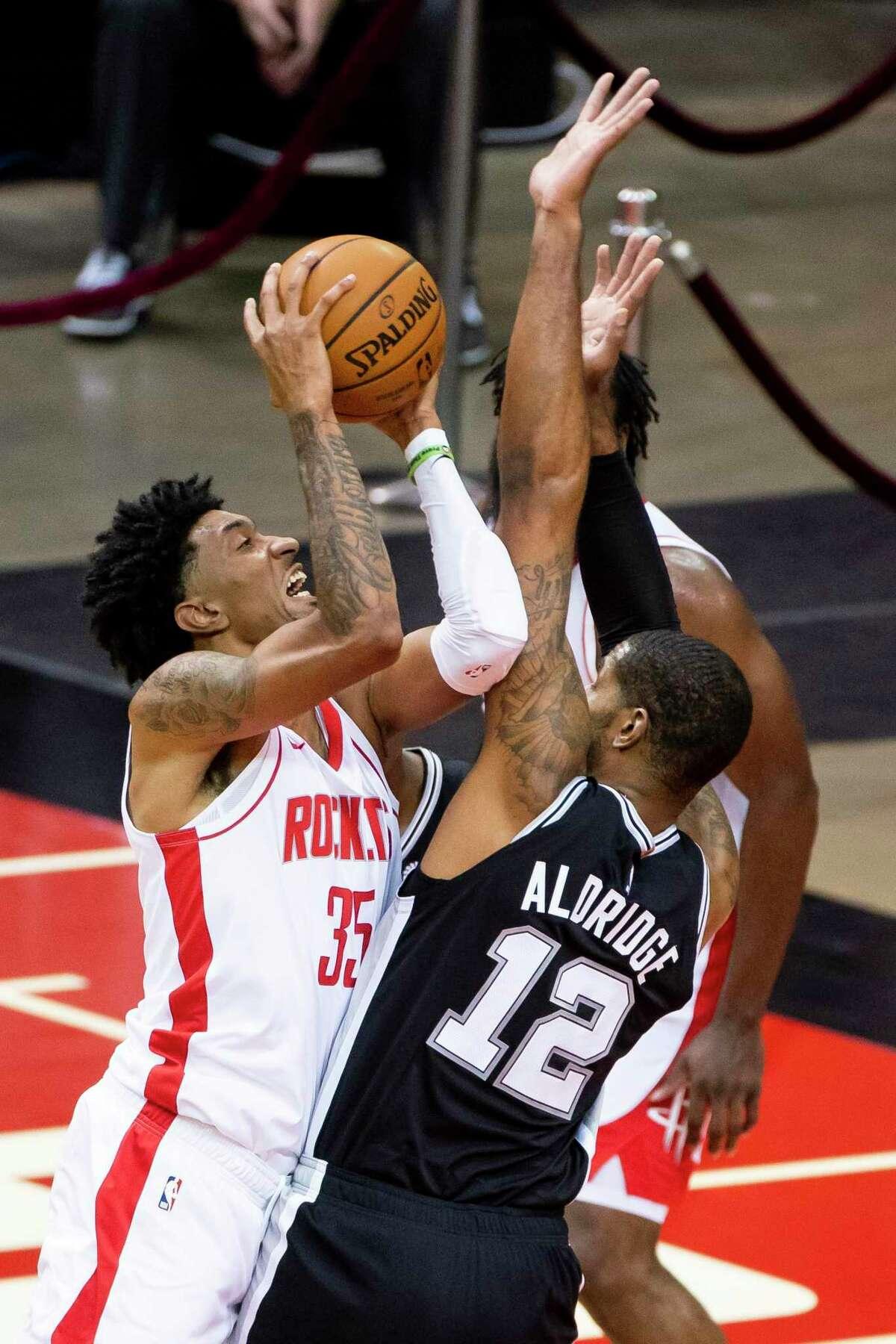 Houston Rockets forward Christian Wood (35) tries to shoot over San Antonio Spurs forward LaMarcus Aldridge (12) during the third quarter of a preseason NBA basketball game between the Houston Rockets and the San Antonio Spurs on Thursday, Dec. 17, 2020, at Toyota Center in Houston.
