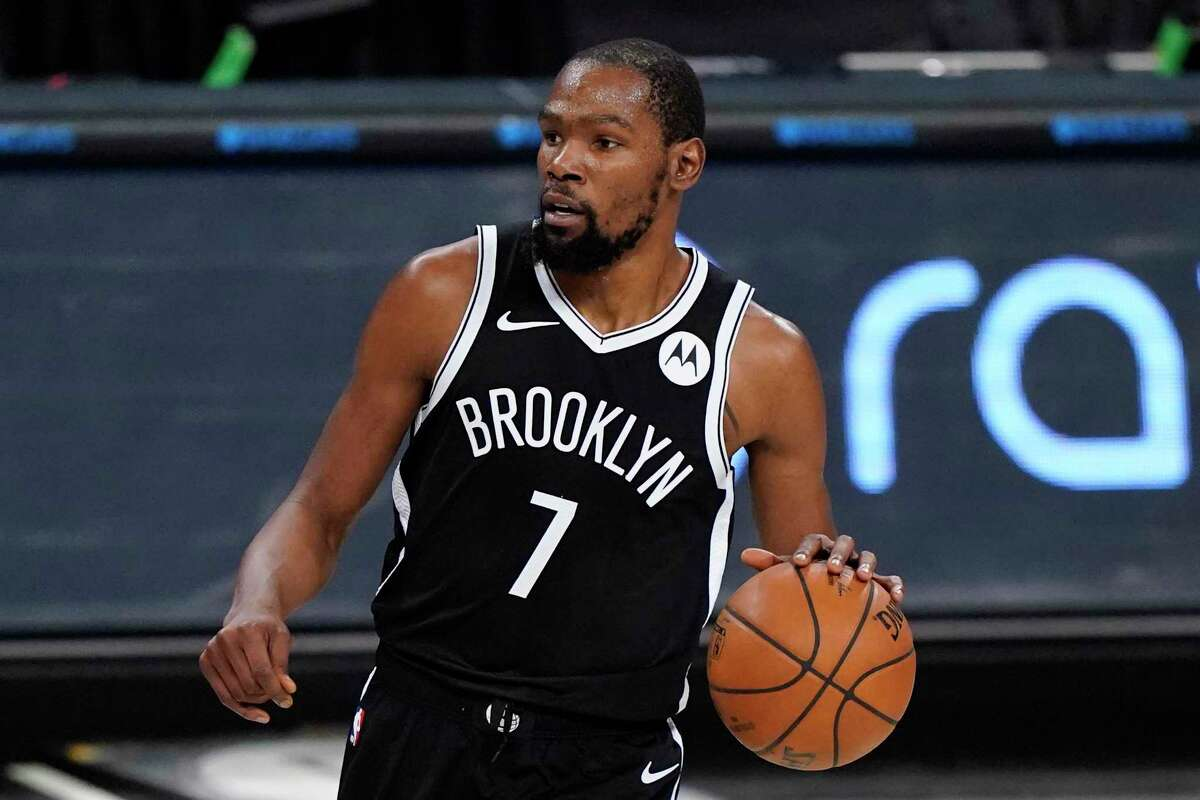 Brooklyn Nets forward Kevin Durant handles the ball during the first half of a preseason NBA basketball game against the Washington Wizards, Sunday, Dec. 13, 2020, in New York.