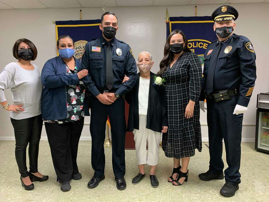 Alberto Juarez is pictured with his family after being sworn in Friday as a sergeant for the LISD Police Department. Photo: Courtesy /LISD