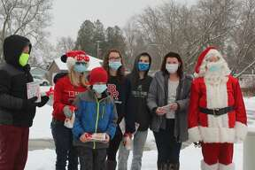 Clad in Christmas gear, staff with the Morton Township Library spent their Saturday passing out holiday treat bags to area families. While having the chance to see Santa and receive a free goodie bag, families were able to stay safely in their vehicles during the drive-thru style event. Clad in Christmas gear, staff with the Morton Township Library spent their Saturday passing out holiday treat bags to area families. While having the chance to see Santa and receive a free goodie bag, families were able to stay safely in their vehicles during the drive-thru style event.