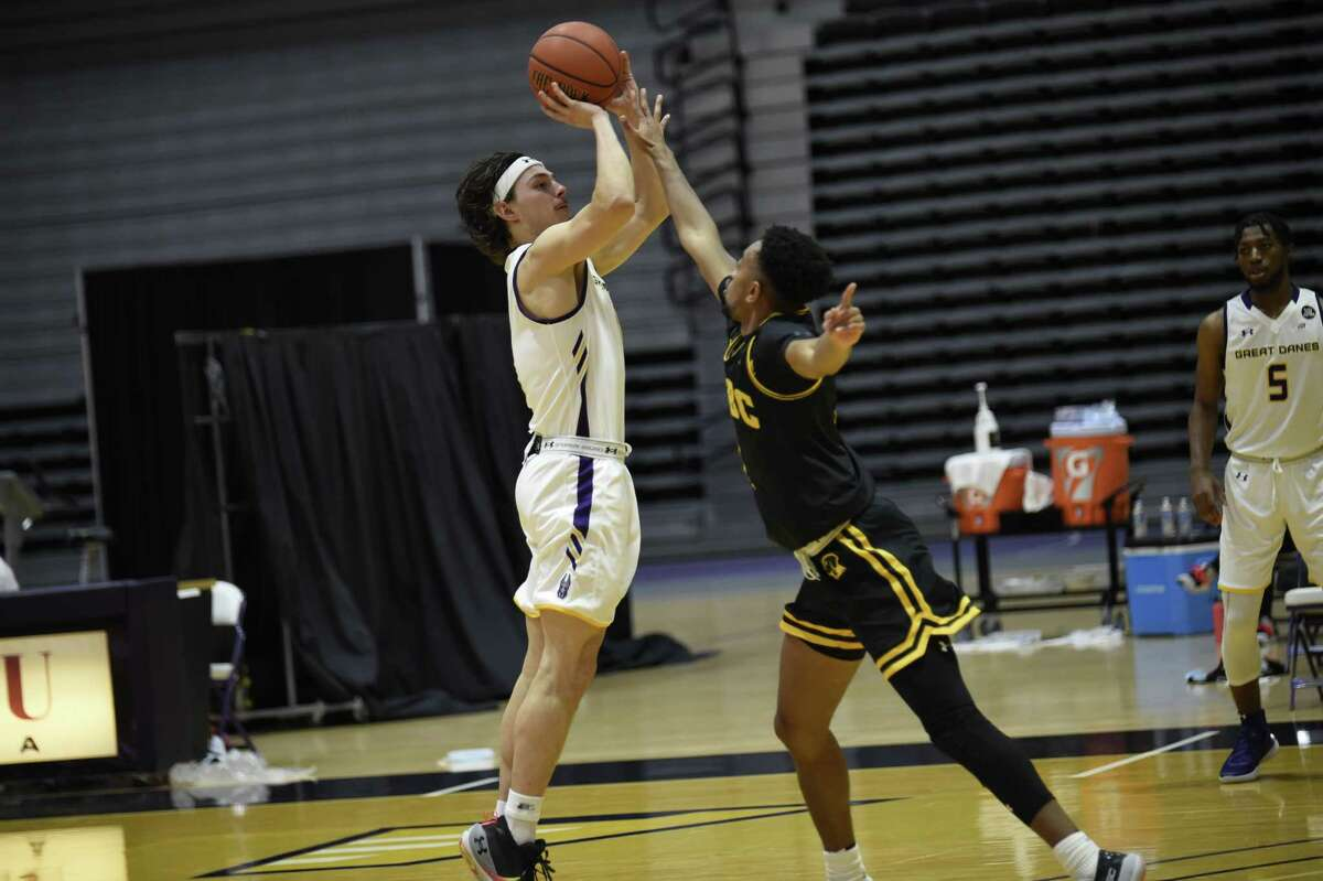 Cameron Healy of UAlbany shoots over a UMBC defender in the Danes' season opener on Saturday, Dec. 19, 2020. (Kathleen Helman / UAlbany)