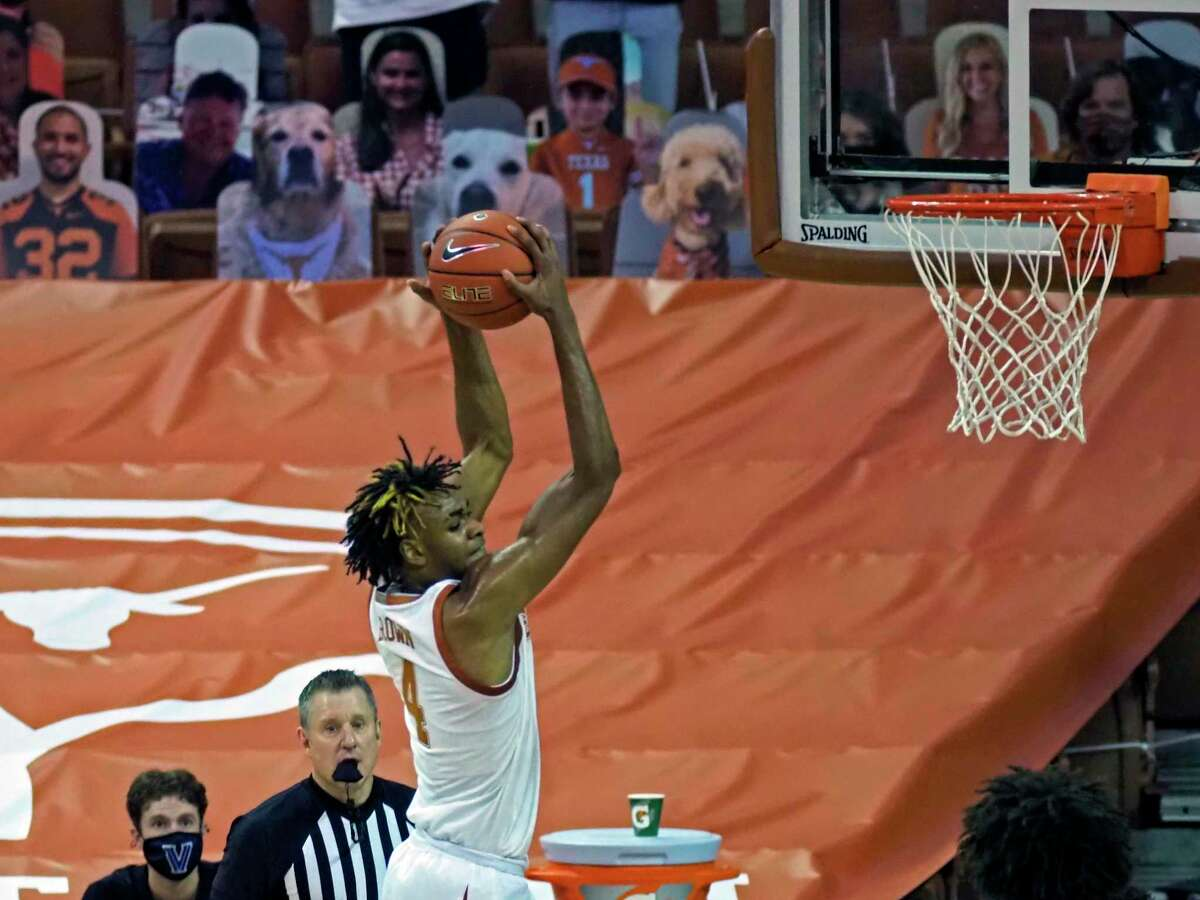 Texas forward Greg Brown doesn't have to be the do-it-all star that he was at Austin Vandergrift and is growing into his role as a cog in the veteran Longhorns' system.