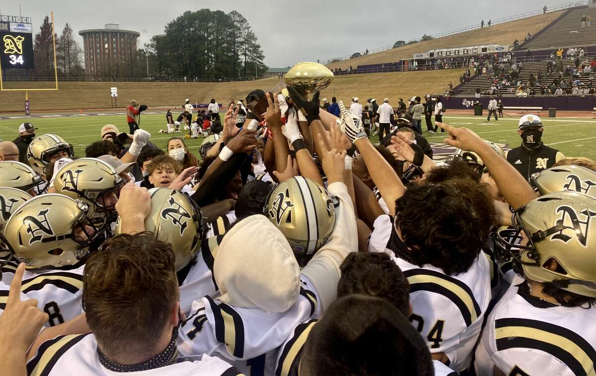 The Nederland Bulldogs celebrate together after a 34-21 win over Longview Pine Tree advanced the team to the regional semifinals for the first time since 2012.