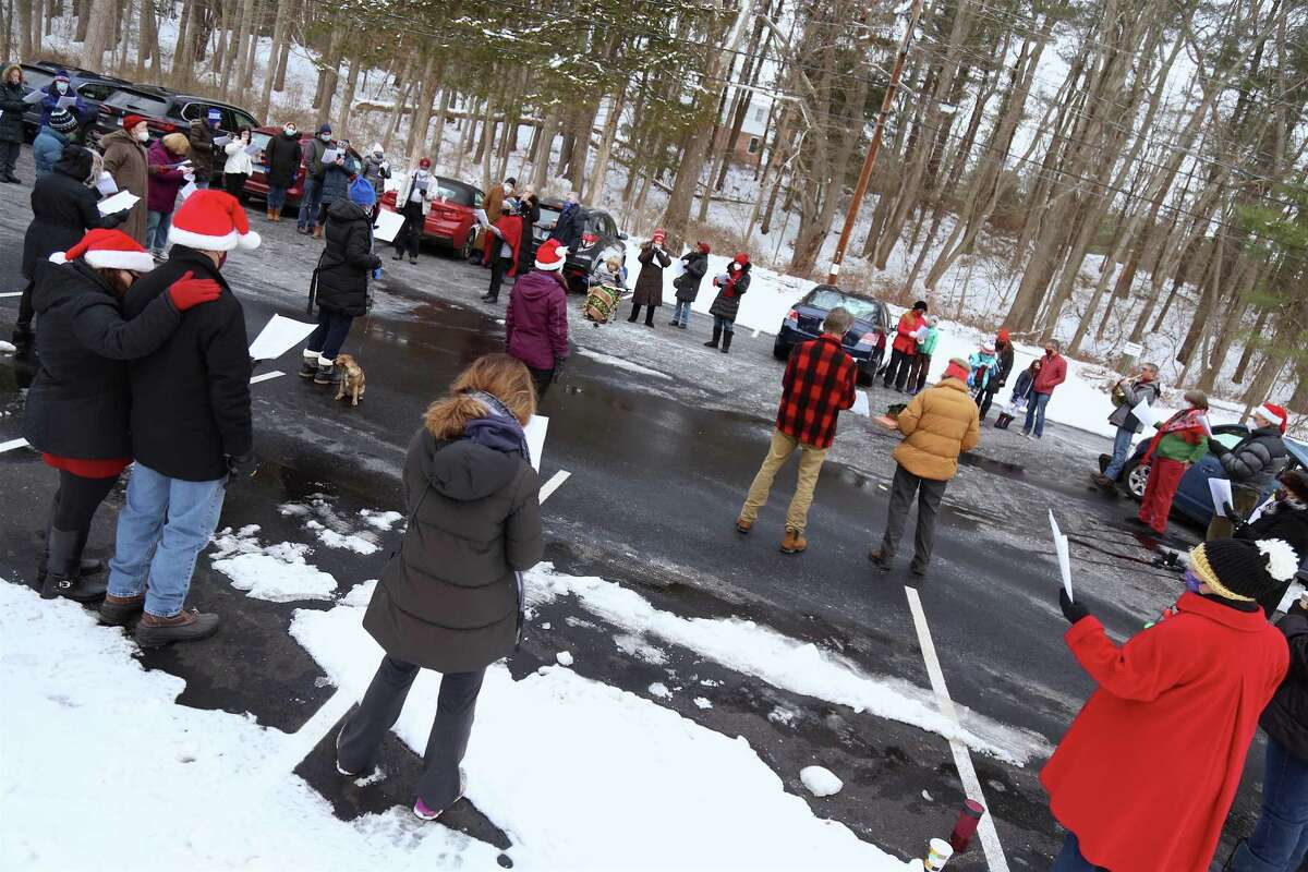 Safe-distance caroling in the parking lot at the caroling get-together at The Unitarian Church in Westport on Saturday, Dec. 19, 2020.
