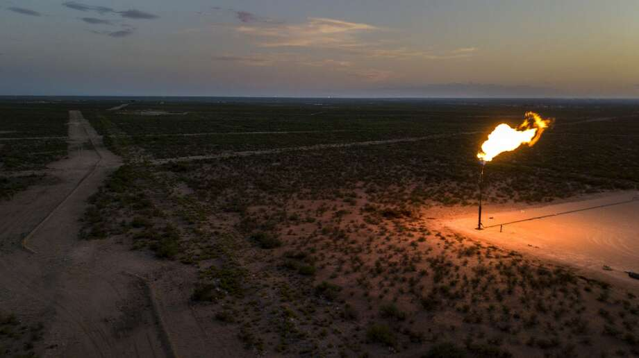 A gas flare is seen at dusk in this aerial photograph taken above a field near Mentone, Texas, on Aug. 31, 2019. Photo: Bronte Wittpenn/Bloomberg / © 2019 Bloomberg Finance LP