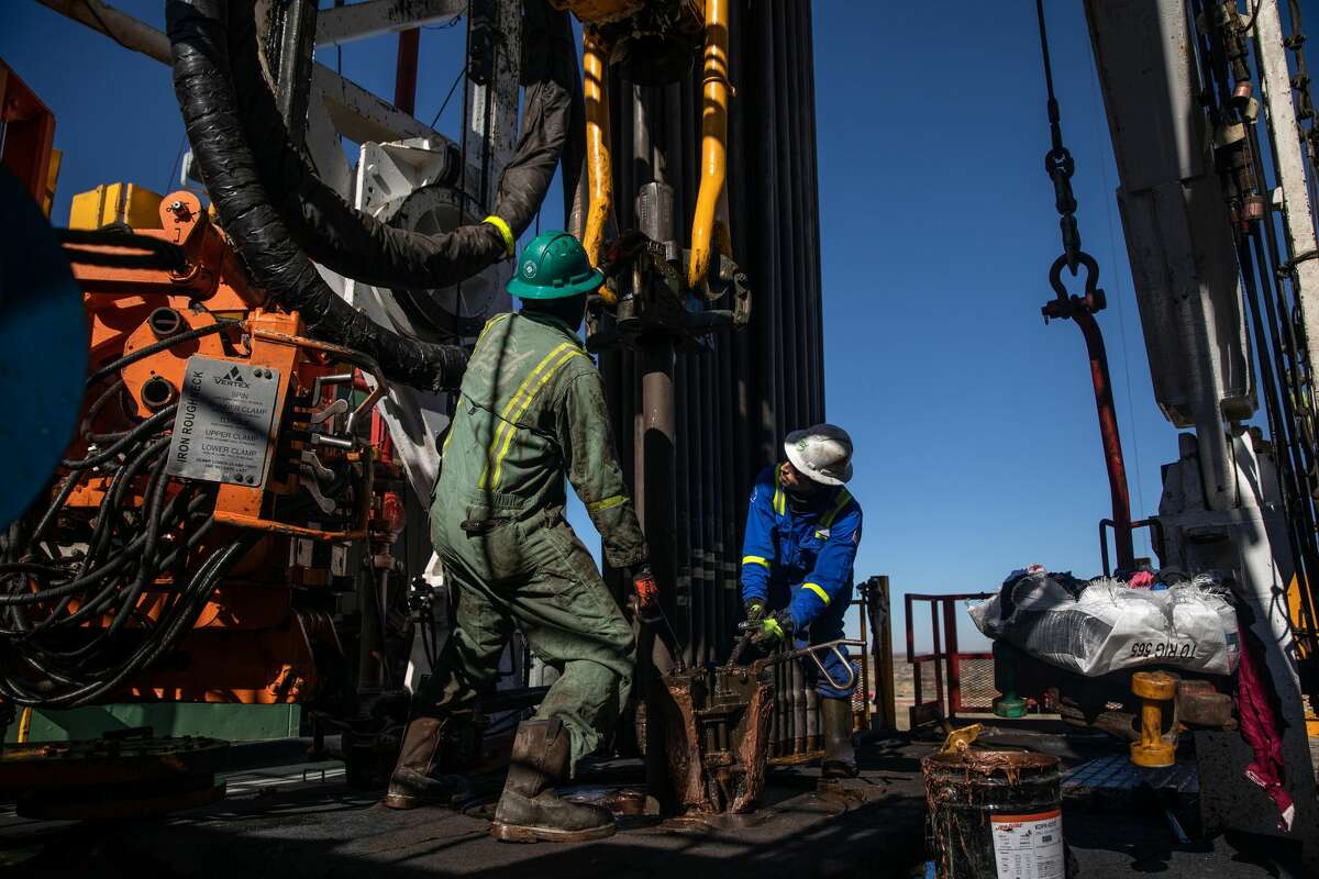 FILE -- Floorhands work on a drilling rig contracted to Shell in the Delaware Basin, near Wink, Texas, on Jan. 25, 2019. Updated data indicate job losses among the state's upstream oil and gas industry were even steeper than originally thought. The good news is that jobs are slowly being added back to the industry.