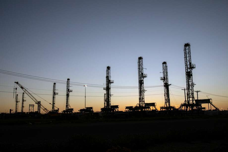 Idled drilling rigs stand outside Odessa in this April 2020 file photo. S&P Global Platts Analytics expects the energy industry to see some recovery in the second half of 2021, but the outlook is overshadowed by a large supply inventory and the coronavirus pandemic. Photo: TAMIR KALIFA/NYT