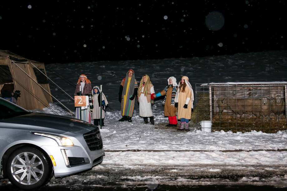 """Actors tell participants to head down the road to continue towards the """"A Walk Through Bethlehem"""" event hosted by Clare Assembly of God Saturday, Dec. 19, 2020 in Clare. (Cody Scanlan/for the Daily News) Photo: (Cody Scanlan/for The Daily News)"""