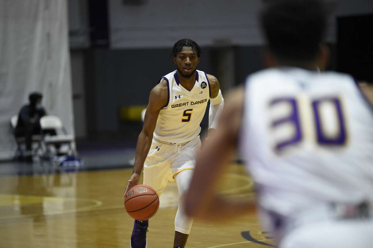 UAlbany junior guard Jamel Horton brings the ball upcourt Saturday, Dec. 19, in an America East Conference game against UMBC at SEFCU Arena. (Kathleen Helman / UAlbany athletics)