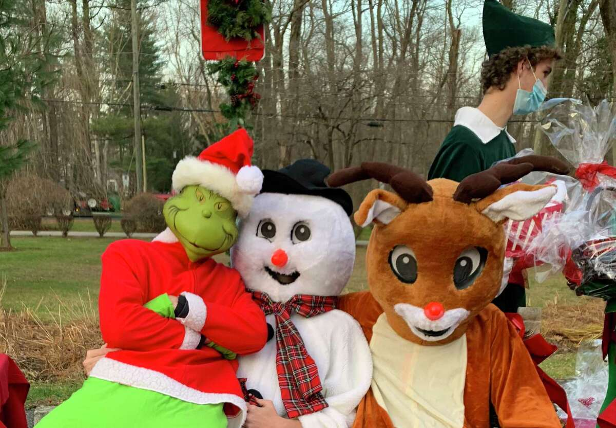 Families and students at Greenwich Country Day recently made the holidays a little happier for staff and residents at Parsonage Cottage. Gift baskets and gift bags were given out and there was a holiday parade in the parking lot including appearances from the Grinch, played by Nick Spizzirri, Frosty, played by Dana Santry, and Rudolph, played by Elliot Spizzirri.