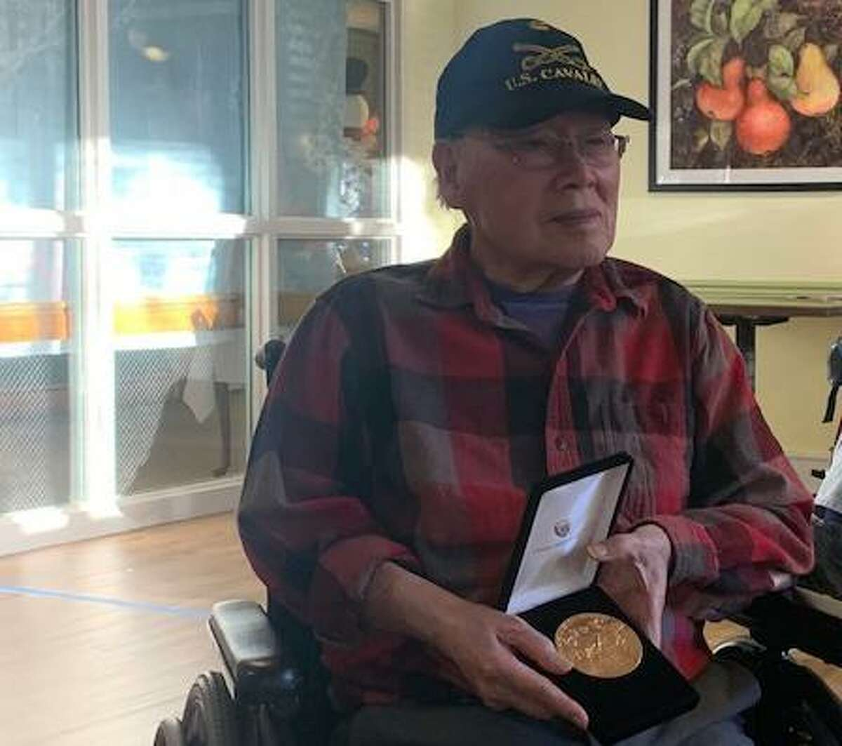 Wilton Meadows Chuck Eng holds the gold medal he was awarded Dec. 11, by the Chinese American Citizens Alliance for his service in the U.S. Army during World War II.