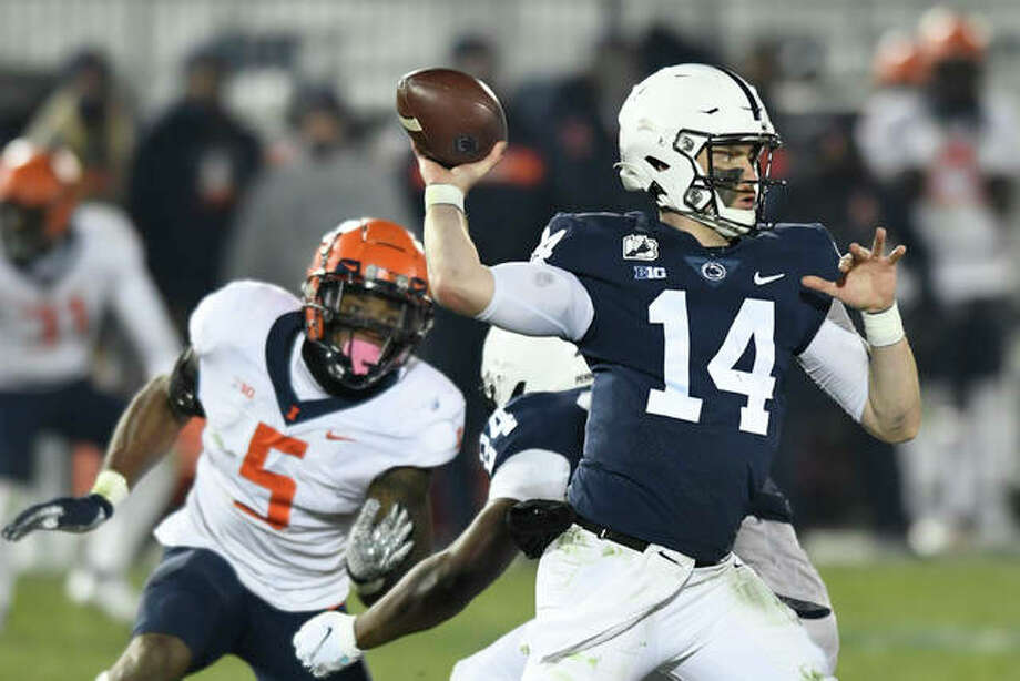 Penn State quarterback Sean Clifford (14) throws a second quarter touchdown pass to wide receiver Jahan Dotson as Illinois linebacker Milo Eifler (5) rushes him during an NCAA college football game in State College, Pa., on Saturday, Dec. 19, 2020. Photo: Associated Press