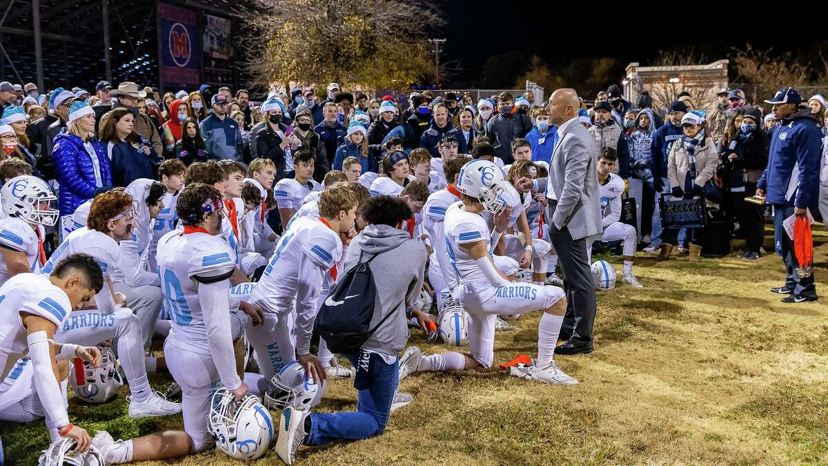 With their runner-up medals draped around their necks, first-year coach Kris Hogan congratulates his team on their achieving the title game. The Cypress Christian Warriors fell in the TAPPS Division III state title game Saturday night, 40-30, to Covenant Christian - Colleyville.
