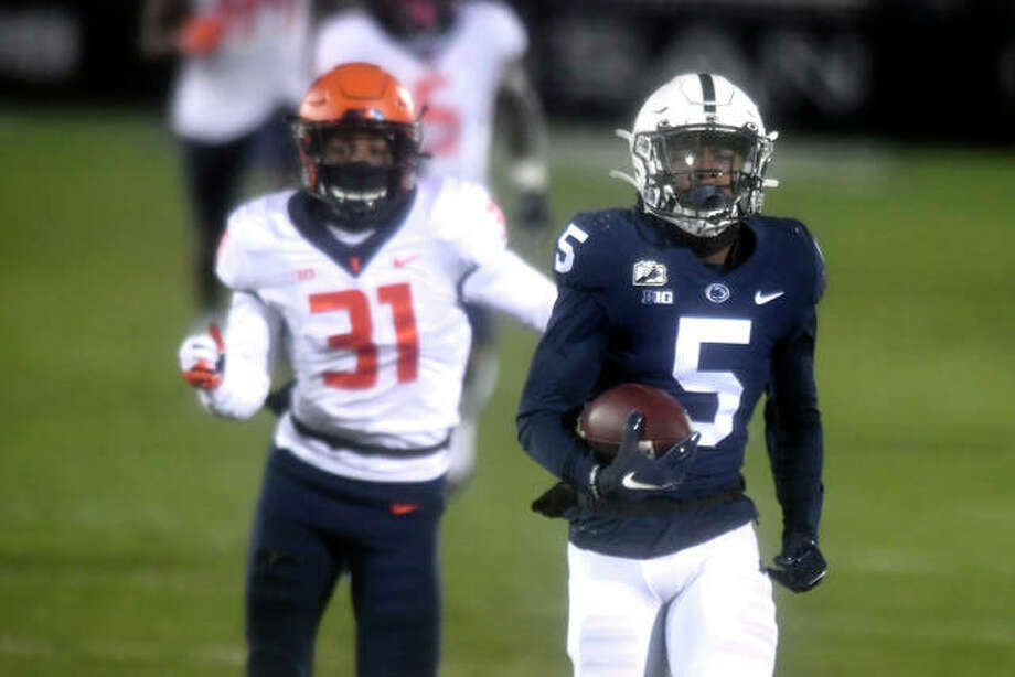 Penn State receiver Jahan Dotson (5) scores a touchdown on a 75-yard pass in the first quarter while Illinois defensive back Devon Witherspoon gives chase (31) Saturday in a Big Ten game in State College, Pa. Photo: Associated Press