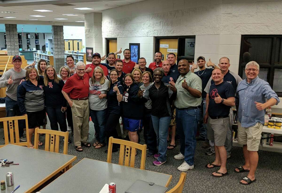 Pictured is Rasmussen with other BRPS staff and board members. The school district's 2018 bond proposal had just passed. (Courtesy photo)